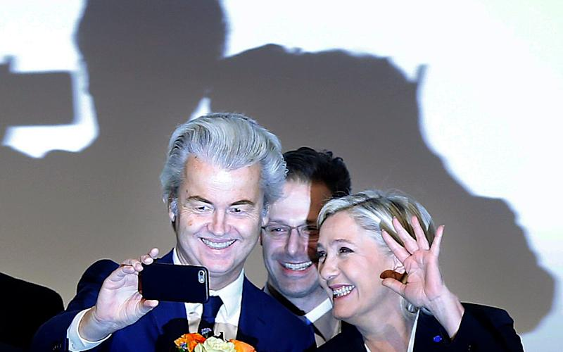 Far-right leader and candidate for next spring presidential elections Marine le Pen from France, right, and Dutch populist anti-Islam lawmaker Geert Wilders