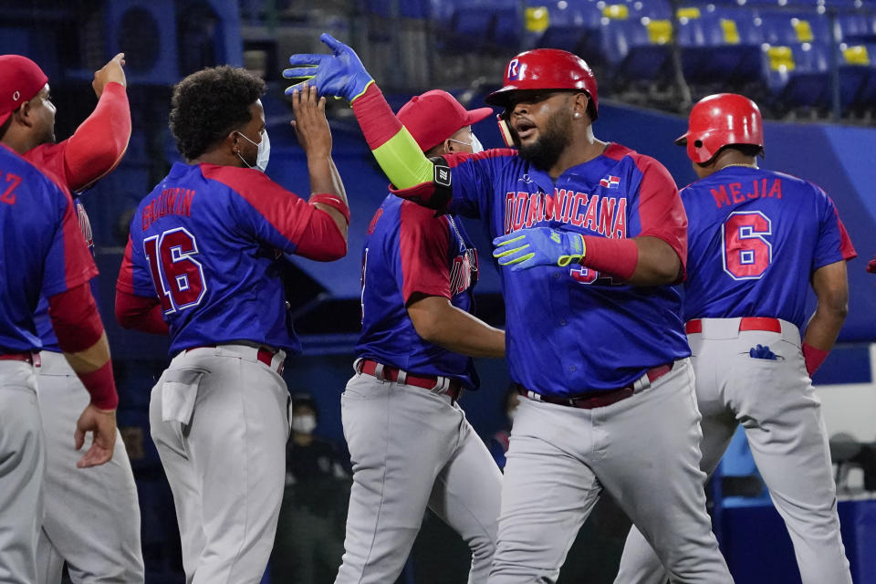 Dominican Republic's Juan Francisco celebrates with teammates his home run in the fourth inning of a baseball game against South Korea at the 2020 Summer Olympics, Sunday, Aug. 1, 2021, in Yokohama, Japan. (AP Photo/Sue Ogrocki)