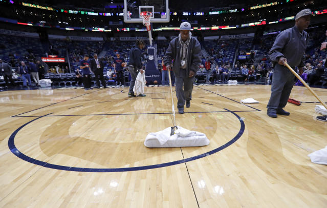 Workers mop the court during a delay for the start of an NBA basketball game against the Indiana Pacers in New Orleans, Wednesday, Feb. 7, 2018. (AP)