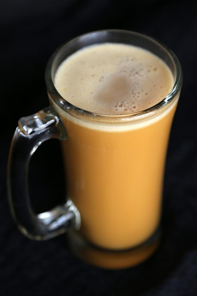 """<p>Young wizards love a refreshing glass of butterbeer, and a real-life version was even made centuries ago in London. What is described as liquid butterscotch or a top-quality cream soda can be replicated with this <a href=""""https://www.popsugar.com/food/Hot-Cold-Butterbeer-Recipe-380247"""" class=""""ga-track"""" data-ga-category=""""Related"""" data-ga-label=""""http://www.popsugar.com/food/Hot-Cold-Butterbeer-Recipe-380247"""" data-ga-action=""""In-Line Links"""">alcoholic butterbeer recipe</a>, made with real butter and real beer. </p>"""