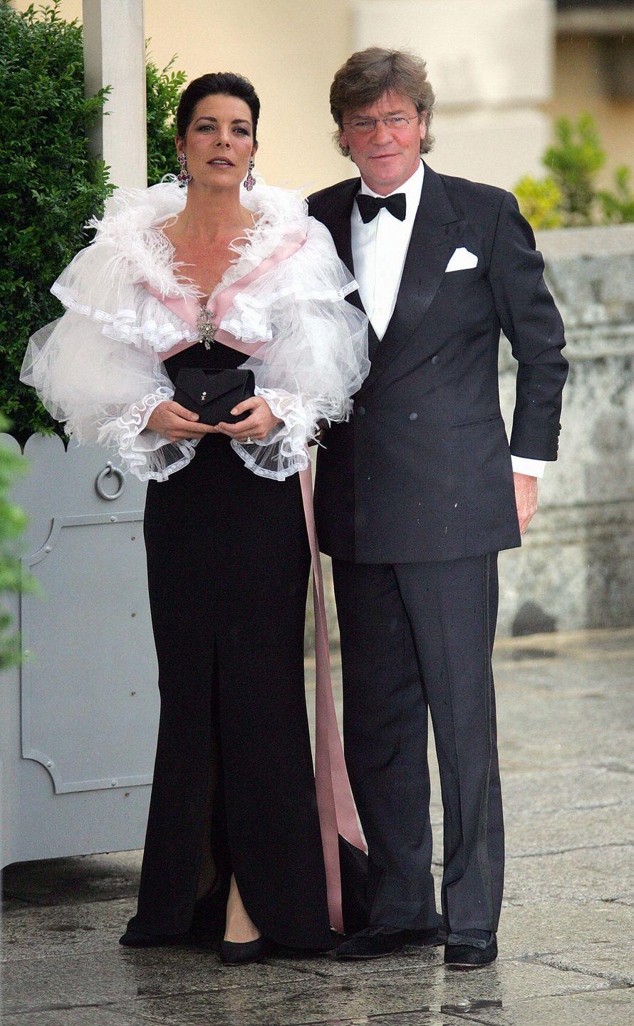 <p>Princess Caroline, in Chanel, and Prince Ernst August (they married in 1999 and separated a decade later) in Madrid for the 2004 wedding celebrations of future King Felipe and Queen Letizia of Spain.</p>