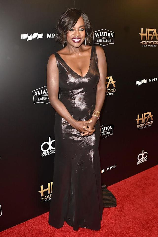 <p>The 52-year-old actress always manages to stun fans with her talent and her style. Davis paired a magenta beauty look with a deep metallic dress by Alberta Ferretti. (Photo: Getty Images) </p>