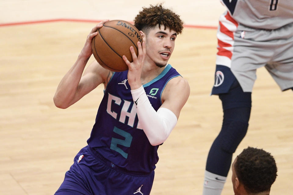 Charlotte Hornets guard LaMelo Ball (2) in action during the second half of an NBA basketball game against the Washington Wizards, Sunday, May 16, 2021, in Washington. (AP Photo/Nick Wass)