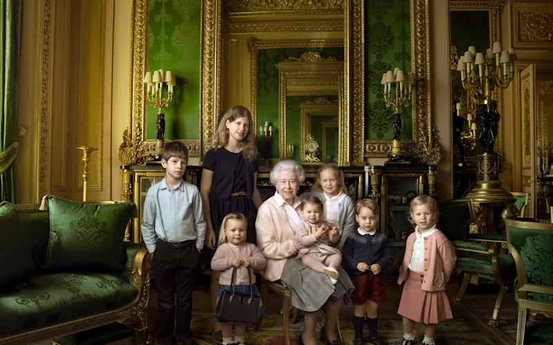 The Queen's official portrait to mark her 90th birthday. Her great-granddaughter Mia Tindall holds her handbag - Credit: Annie Liebowitz