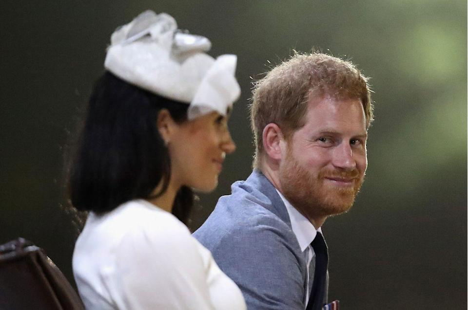 <p>Harry glanced at his wife during a welcome ceremony in Suva, Fiji.</p>