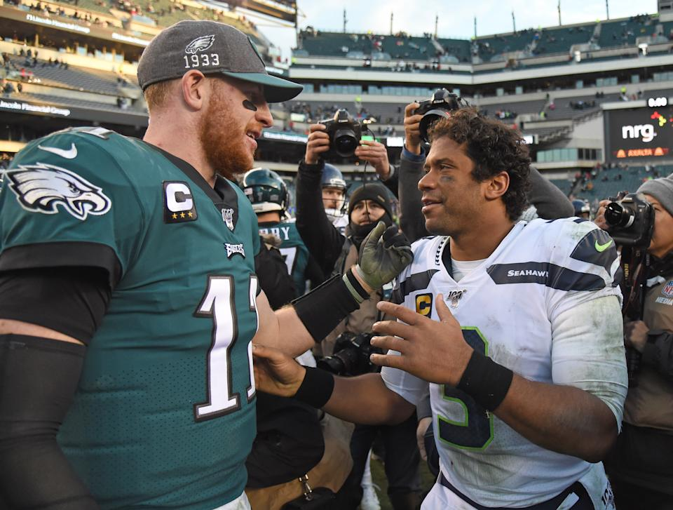 Nov 24, 2019; Philadelphia, PA, USA; Philadelphia Eagles quarterback Carson Wentz (11) and Seattle Seahawks quarterback Russell Wilson (3) on the field after game at Lincoln Financial Field. Mandatory Credit: Eric Hartline-USA TODAY Sports
