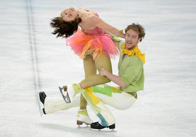 <p>Garden-inspired, complete with flower petal skirts, the French ice dancing team were one of the most colorful teams at the Sochi Games. Pechalat combined her pastel orange, pink and yellow dress with sheer green tights. </p>