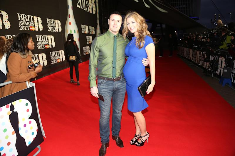 Paddy McGuinness, left, and wife Christine Martin seen arriving at the BRIT Awards 2013 at the o2 Arena on Wednesday, Feb. 20, 2013, in London. (Photo by John Marshall/Invision/AP)
