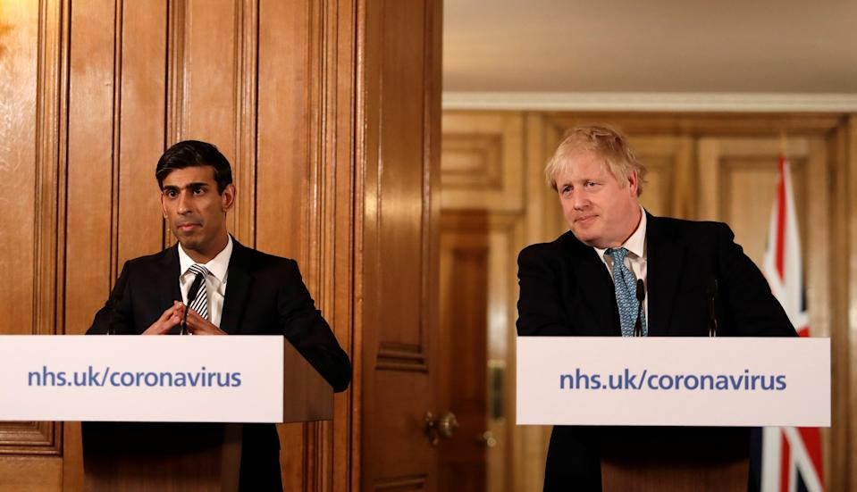Britain's Prime Minister Boris Johnson and Chancellor of the Exchequer Rishi Sunak attend a news conference on the ongoing situation with the coronavirus disease (COVID-19) in London, Britain March 17, 2020. Matt Dunham/Pool via REUTERS
