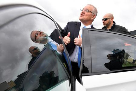 Prime Minister Scott Morrison greets neighbours after visiting a housing construction site in Clifton Springs, Australia, May 15, 2019. AAP Image/Mick Tsikas/via REUTERS