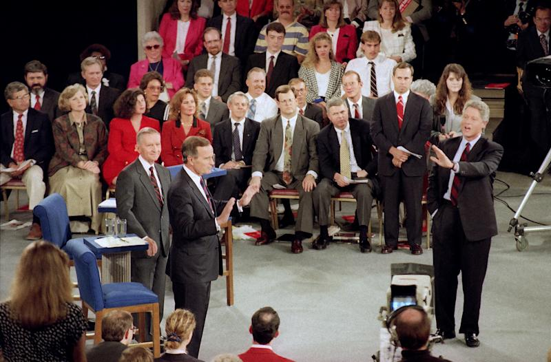 Democratic candidate Bill Clinton leaves his seat to answer a question during presidential debate at the University of Richmond's Robins Center in Richmond, Va., Oct. 15, 1992. President Bush, left, and independent candidate Ross Perot listen. (Steve Helber/AP)