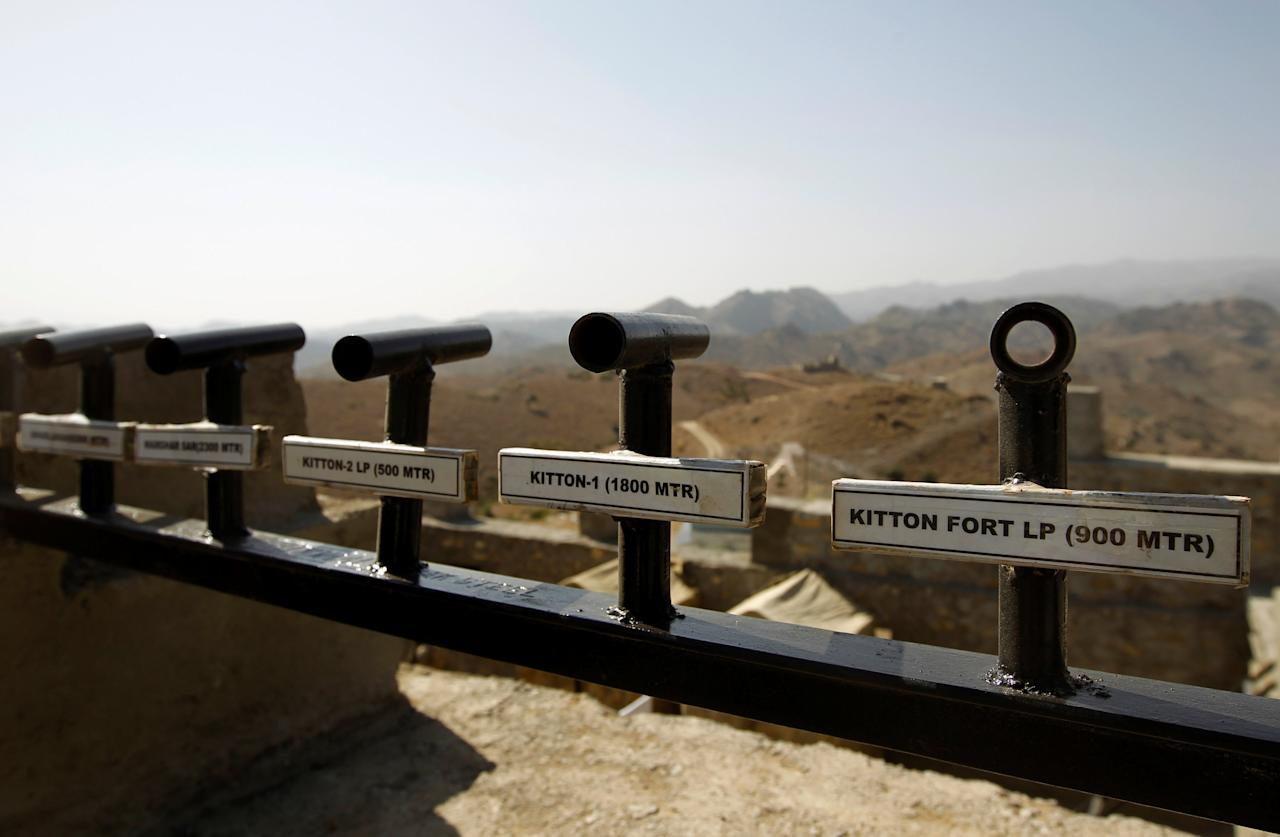 Location and range information is seen on a wall in the Kitton outpost along the border fence on the border with Afghanistan in North Waziristan, Pakistan October 18, 2017.  REUTERS/Caren Firouz
