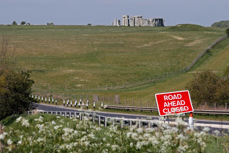 A sign warns of a road closure on the route to the prehistoric monument at Stonehenge in southern England, on April 26, 2020, closed during the national lockdown due to the novel coronavirus COVID-19 pandemic. - Britain's health ministry on Saturday said 813 more people had died after testing positive for COVID-19 in hospital, taking the death toll to 20,319. (Photo by Adrian DENNIS / AFP) (Photo by ADRIAN DENNIS/AFP via Getty Images)
