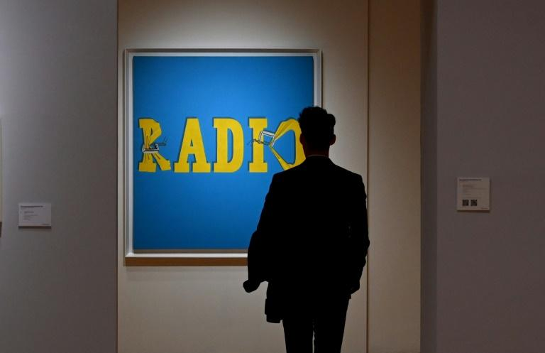 "A person looks at artist Ed Ruscha's ""Hurting the Word Radio #2"" during a press preview on November 1, 2019, for the Christie's Post-War and Contemporary Art Evening Sale in New York on November 13"