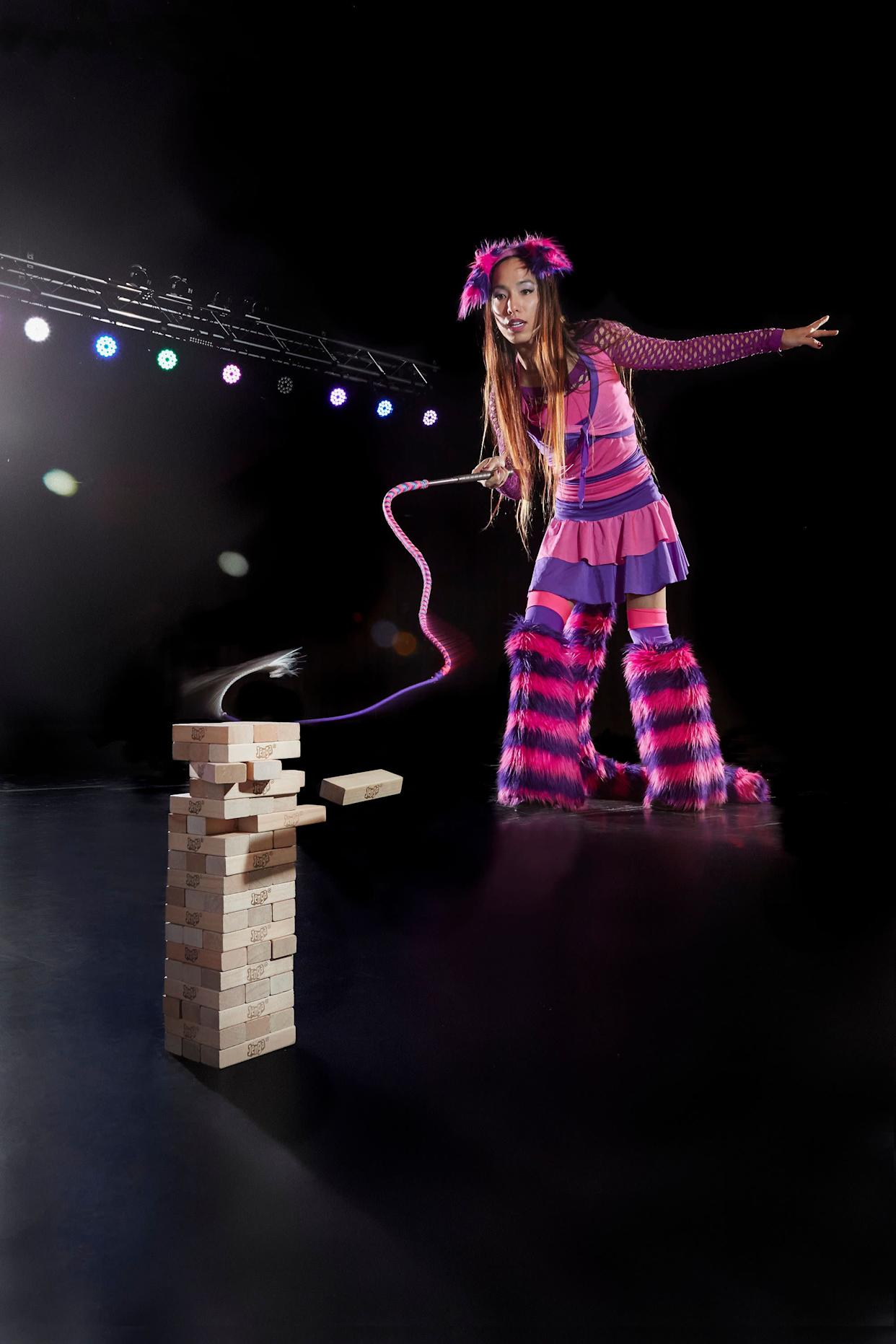 April Choi holds the record for most Jenga blocks removed by whip in one minute: 4. She achieved the record in Peoria, Illinois, on Sept.27, 2016.