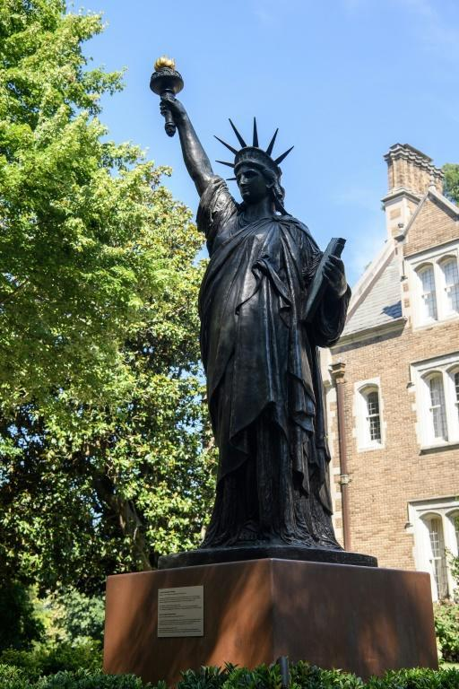 The bronze statue stands at around 10 feet tall, diminutive compared to the renowned statue by Frederic Auguste Bartholdi on Liberty Island in New York City