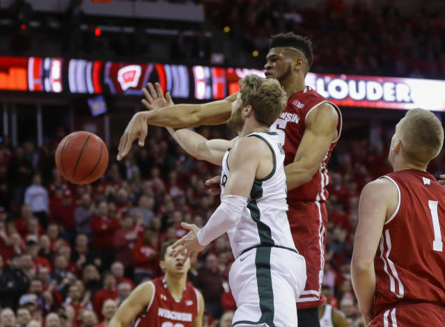 Wisconsin's Charles Thomas (15) blocks a a shot by Michigan States's Kyle Ahrens (0) during the first half of an NCAA college basketball game Tuesday, Feb. 12, 2019, in Madison, Wis. (AP Photo/Andy Manis)