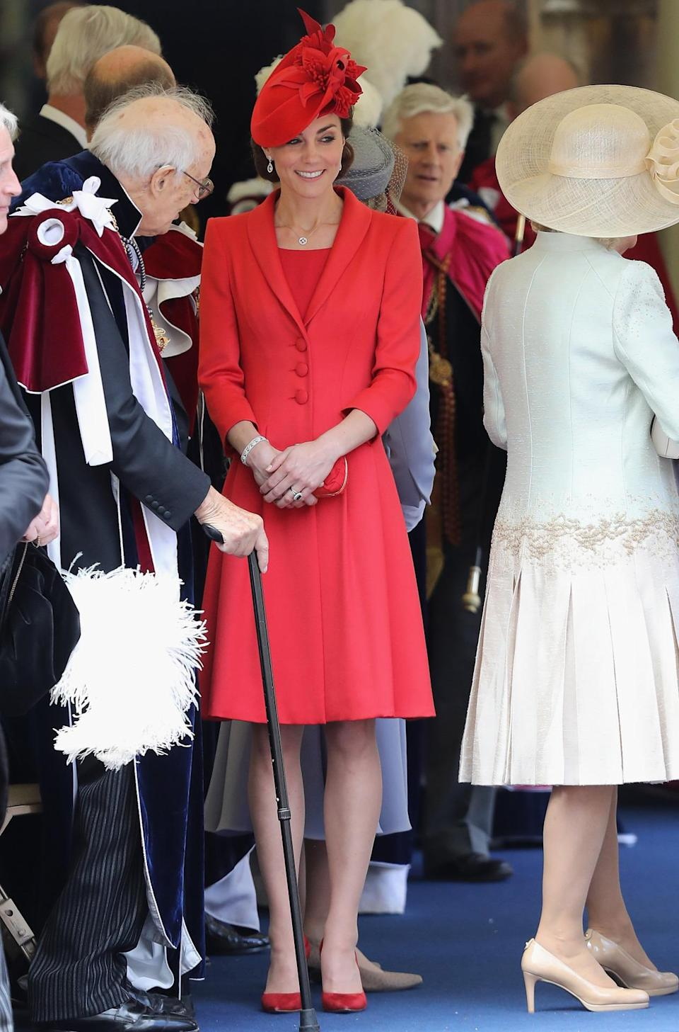 <p>Kate chose a bright red bespoke ensemble by Catherine Walker for a service at Windsor Castle. Matching red suede Gianvito Rossi pumps and an Alexander McQueen clutch proved to be the perfect accessories.</p><p><i>[Photo: PA]</i></p>