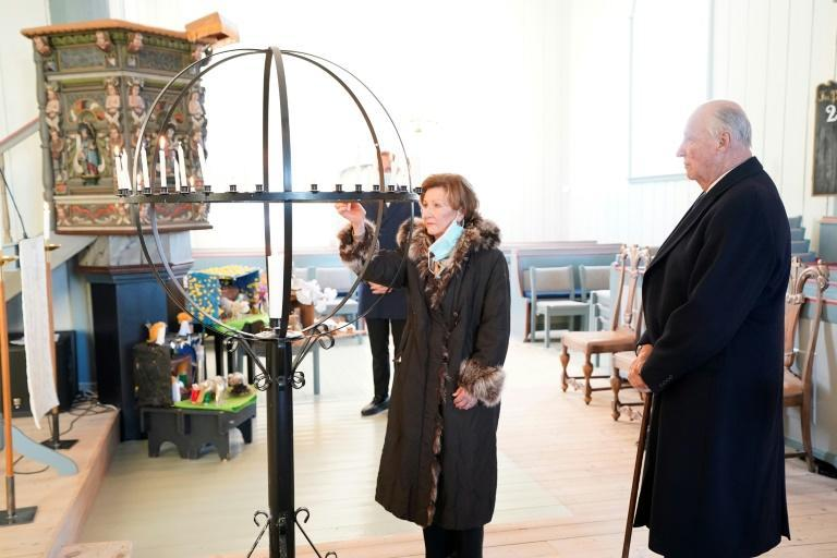 King Harald and Queen Sonja visited the site and lit candles in a local church