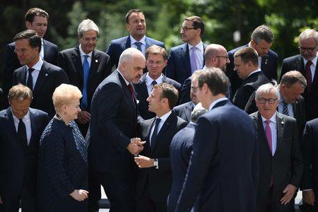 Bulgaria's Prime Minister Boyko Borissov chats with France's President Emmanuel Macron among other heads of state during the family photo at the EU-Western Balkans Summit in Sofia, Bulgaria, May 17, 2018. Vassil Donev/Pool via Reuters