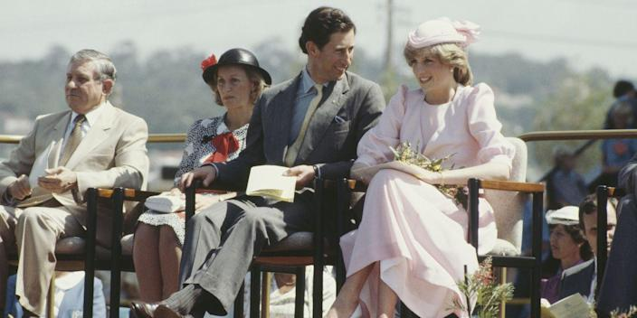 <p>While visiting Newcastle, Australia with Prince Charles, Diana wears a light pink dress by Catherine Walker and a hat by John Boyd. </p>