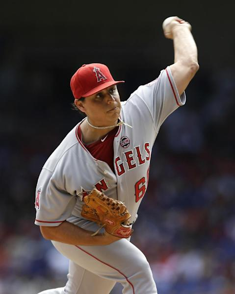 Los Angeles Angels starting pitcher Jason Vargas (60) delivers to the Texas Rangers in the first inning of a baseball game, Sunday, Sept. 29, 2013, in Arlington, Texas. (AP Photo/Tony Gutierrez)