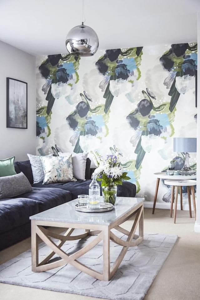 "<p>A soft and relaxing warm grey is used in the sitting area of Judy Murray's Wimbledon flat. The plump charcoal sofa is softened with cushions in colours picked out from the abstract floral English Rose wallpaper, which creates a dramatic backdrop.  A textured grey rug under the coffee table completes the living room.  </p><p>Pictured: <a href=""https://www.housebeautiful.com/uk/renovate/homes-makeovers/a1859/judy-murray-wimbledon-home-makeover-look/"" target=""_blank"">Judy Murray's Wimbledon flat makeover: from lad's pad to stylish sanctuary</a></p>"