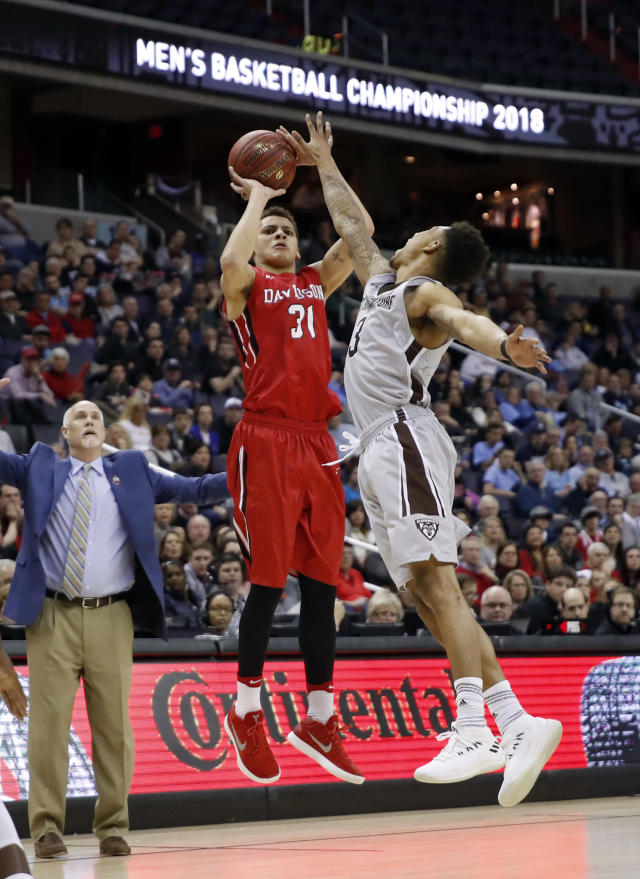 Davidson guard Kellan Grady (31) shoots in front of St. Bonaventure guard Jaylen Adams (3) during the first half of an NCAA college basketball game in the semifinals of the Atlantic 10 Conference tournament, Saturday, March 10, 2018, in Washington. (AP Photo/Alex Brandon)