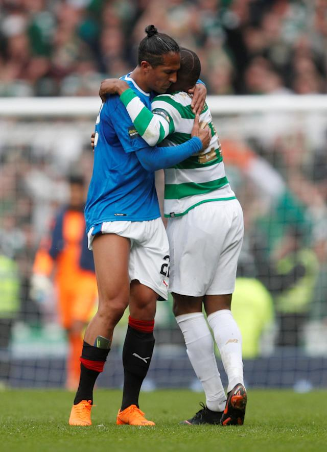 Soccer Football - Scottish Cup Semi Final - Celtic vs Rangers - Hampden Park, Glasgow, Britain - April 15, 2018 Rangers' Bruno Alves hugs Celtic's Olivier Ntcham after the match REUTERS/Russell Cheyne