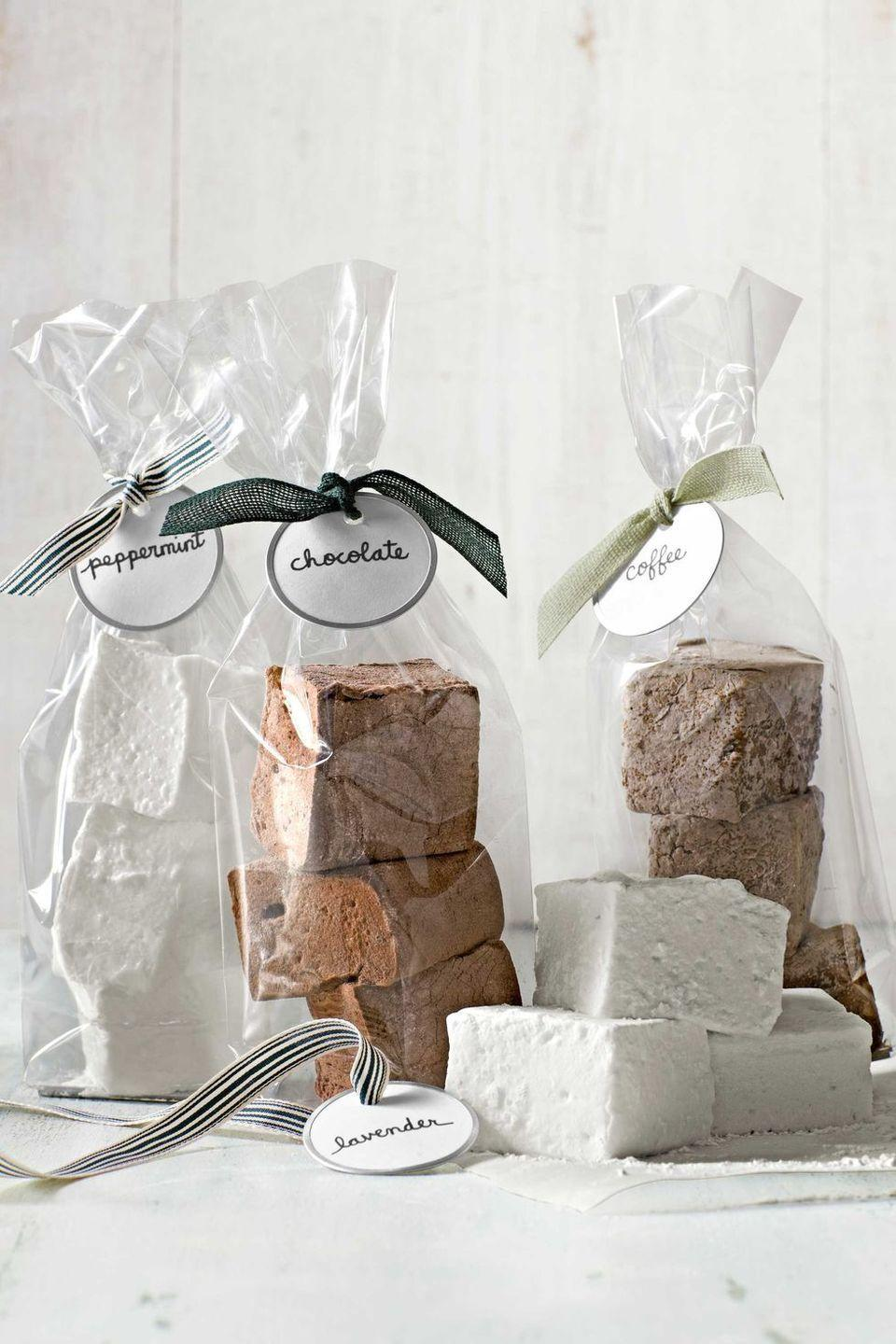 """<p>Make Christmas presents for a crowd by baking a batch of these gourmet marshmallows, then packaging them in a glassine bag. </p><p><strong><a href=""""https://www.countryliving.com/food-drinks/recipes/a4130/gourmet-marshmallows-recipe-clv1212/"""" rel=""""nofollow noopener"""" target=""""_blank"""" data-ylk=""""slk:Get the recipe."""" class=""""link rapid-noclick-resp"""">Get the recipe.</a></strong> </p><p><a class=""""link rapid-noclick-resp"""" href=""""https://www.amazon.com/Resealable-Cellophane-Bakery-Candle-UNIQUEPACKING/dp/B018HFT6TK/?tag=syn-yahoo-20&ascsubtag=%5Bartid%7C10050.g.645%5Bsrc%7Cyahoo-us"""" rel=""""nofollow noopener"""" target=""""_blank"""" data-ylk=""""slk:SHOP BAGS"""">SHOP BAGS</a></p>"""