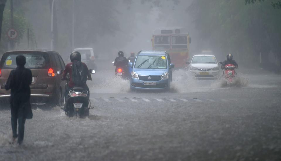 Vehicles ply at on a road at Colaba amid a heavy water-logging due to Cyclone Tauktae in Mumbai, Monday, May 17, 2021.