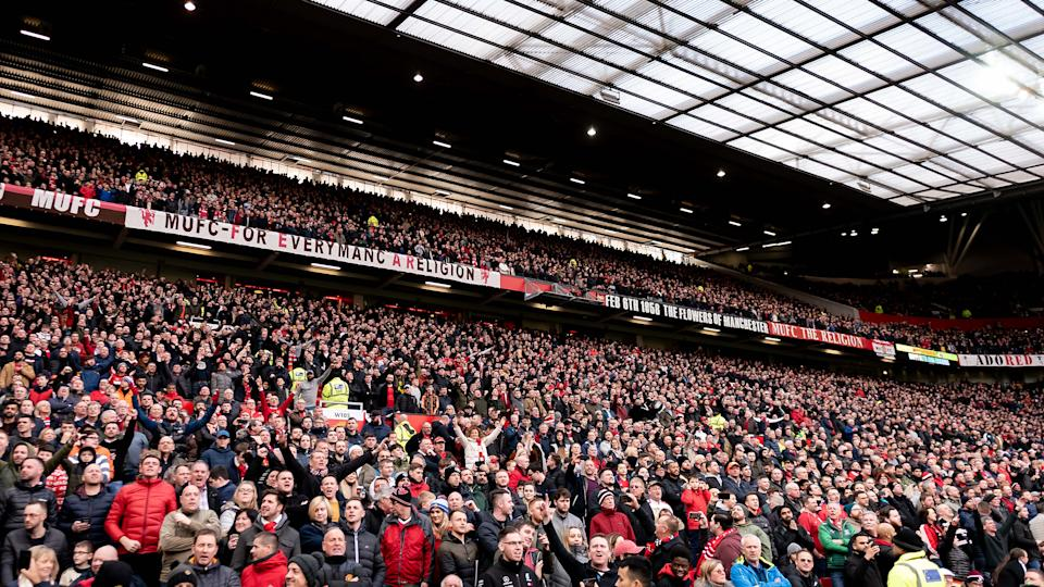 MANCHESTER, ENGLAND - MARCH 08: Manchester United fans watch from the stand during the Premier League match between Manchester United and Manchester City at Old Trafford on March 08, 2020 in Manchester, United Kingdom. (Photo by Ashley Donelon/Manchester United via Getty Images)