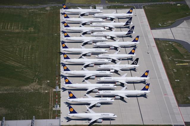 SCHOENEFELD, GERMANY - JUNE 01: Passenger planes of airline Lufthansa that have been temporarily pulled out of service stand parked at Berlin-Brandenburg Airport during the coronavirus crisis. Photo: Sean Gallup/Getty Images