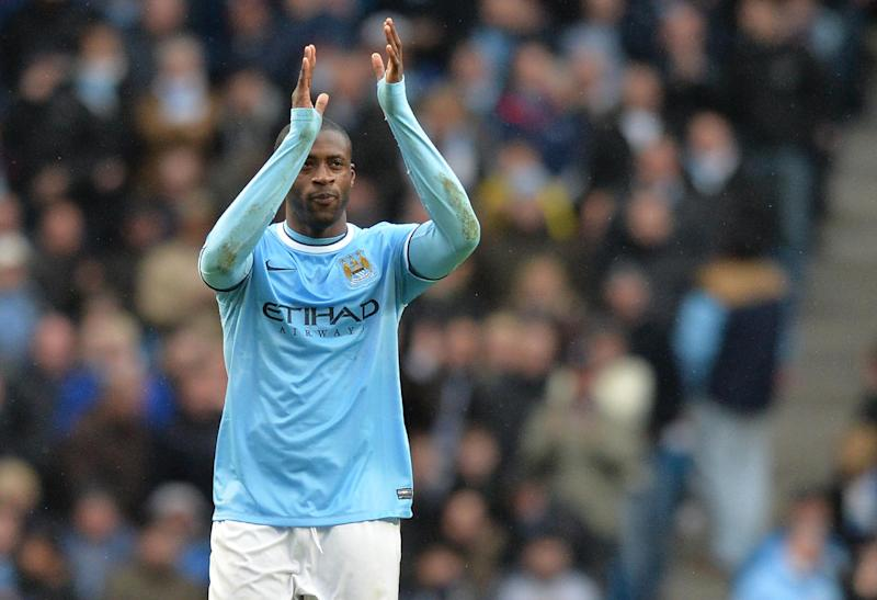 Manchester City midfielder Yaya Toure celebrates after scoring his team's third goal and completing his hat-trick during an English Premier League match at the Etihad Stadium in Manchester, north-west England, on March 22, 2014 (AFP Photo/Paul Ellis)