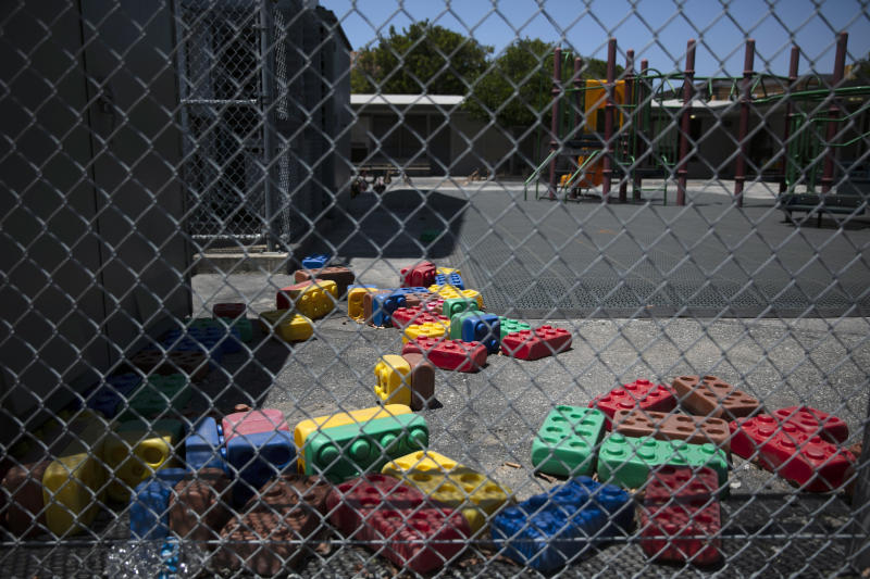 Dusty Lego-style toys are scattered in the playground of an elementary school in Los Angeles, Friday, July 17, 2020. California Gov. Gavin Newsom laid out strict criteria Friday for school reopenings that makes it unlikely the vast majority of districts will have classroom instruction in the fall as the coronavirus pandemic surges. (AP Photo/Jae C. Hong)