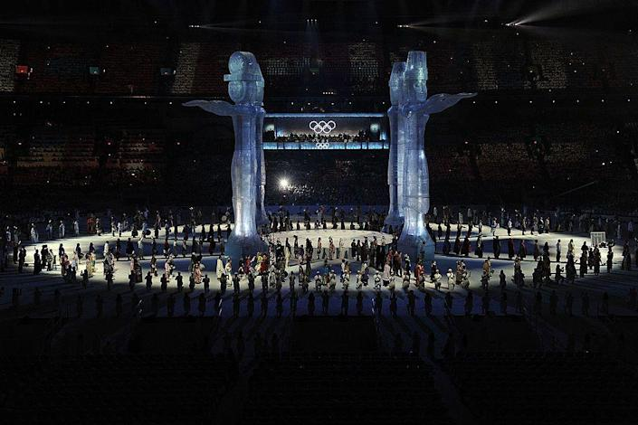 """<p>Dancers perform around four totems, which represent the <a href=""""http://blogs.wsj.com/dailyfix/2010/02/12/winter-olympics-opening-ceremony-diary/"""" rel=""""nofollow noopener"""" target=""""_blank"""" data-ylk=""""slk:four host First Nations"""" class=""""link rapid-noclick-resp"""">four host First Nations</a>.</p>"""