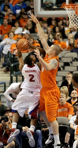 SMU forward Shawn Williams (2) goes to the basket defended by Oklahoma St. center Philip Jurick (44) in the first half of an NCAA basketball game in Dallas, Wednesday, Dec. 28, 2011. (AP Photo/Matt Strasen)