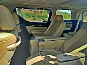 What is on the outside pales in comparison to the interior. Getting in requires the electric doors to slide out. The rear seat or the second row is almost as spacious as a living room. There is massive space at hand and the two plump captain seats are sumptuous.