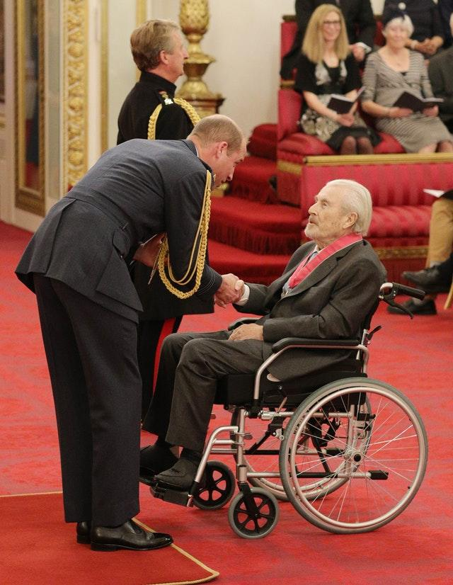Terry O'Neill at an investiture ceremony with the Duke of Cambridge