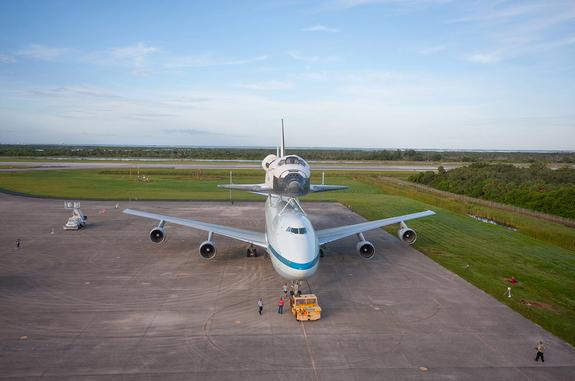 NASA's Shuttle Carrier Aircraft (SCA) is parked on the apron of the Shuttle Landing Facility at the Kennedy Space Center in Florida with space shuttle Endeavour secured on its back on Sept. 16, 2012. The SCA, a modified 747 jetliner, will fly E