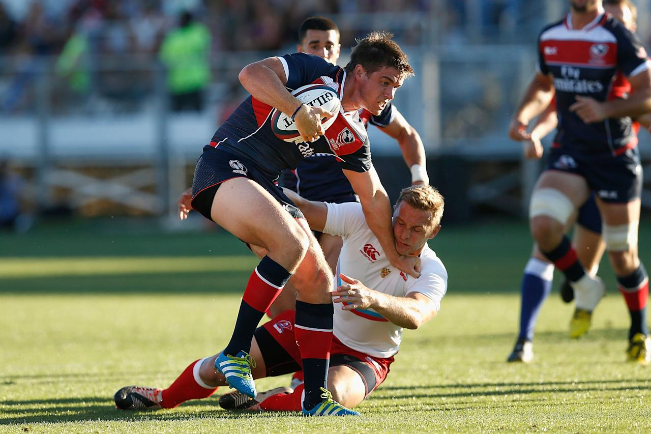 SACRAMENTO, CA - JUNE 25: AJ MacGinty of the United States fends off a tackle in the first half of the match against Russia at Bonney Field on June 25, 2016 in Sacramento, California. Lachlan Cunningham/Getty Images/AFPSACRAMENTO, CA - JUNE 25: AJ MacGinty of the United States fends off a tackle in the first half of the match against Russia at Bonney Field on June 25, 2016 in Sacramento, California. Lachlan Cunningham/Getty Images/AFP (AFP Photo/Lachlan Cunningham)