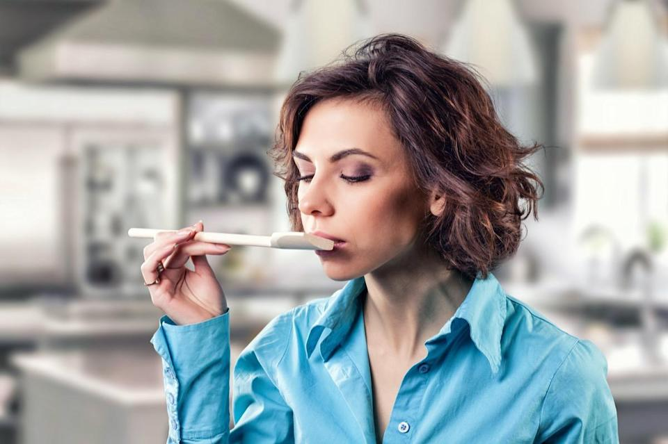 girl with a spoon near a mouth