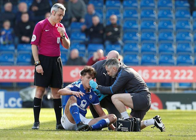 "Soccer Football - League Two - Chesterfield vs Notts County - Proact Stadium, Chesterfield, Britain - March 25, 2018 Chesterfield's Sid Nelson receives medical attention after sustaining an injury Action Images/Craig Brough EDITORIAL USE ONLY. No use with unauthorized audio, video, data, fixture lists, club/league logos or ""live"" services. Online in-match use limited to 75 images, no video emulation. No use in betting, games or single club/league/player publications. Please contact your account representative for further details."