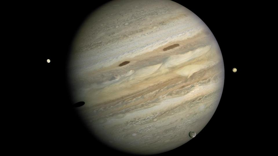 A depiction of Jupiter and its many large moons.