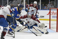 Colorado Avalanche goaltender Philipp Grubauer (31) prepares to block a shot on goal from St. Louis Blues' Jordan Kyrou (25) during the second period in Game 3 of an NHL hockey Stanley Cup first-round playoff series Friday, May 21, 2021, in St. Louis. (AP Photo/Scott Kane)
