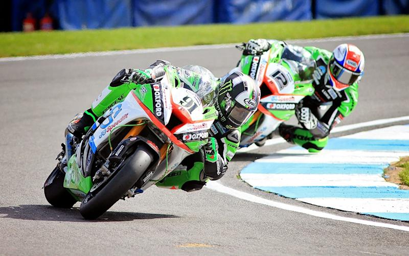 Leon Haslam leads his team-mate Luke Mossey on the way to a maximum 50-point haul from the opening round at Donington Park - Rex Features