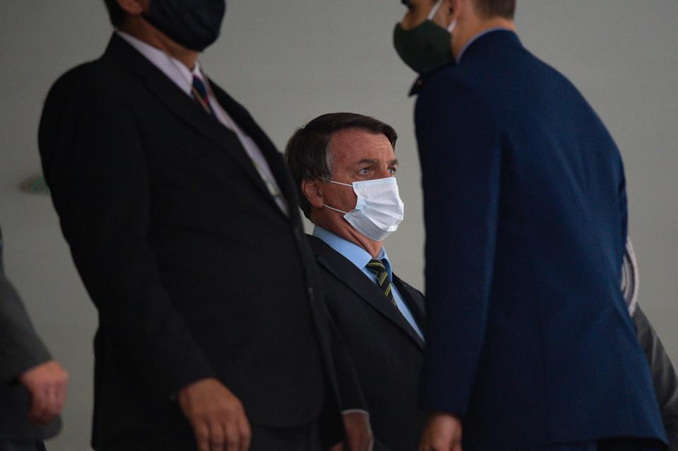 """BRASILIA, BRAZIL - AUGUST 24: Jair Bolsonaro, President of Brazil, looks on wearing a protective mask before the """"Brazil Vencendo a COVID"""" (Brazil overcomingo COVID) event amidst the coronavirus(COVID-19) pandemic at the Planalto Palaceon August 24, 2020 in Brasilia. Bolsonaro defended the use of chloroquine in the treatment of coronovirus.Brazil has over 3.582,000 confirmed positive cases of Coronavirus and has over 114,474 deaths. (Photo by Andressa Anholete/Getty Images)"""