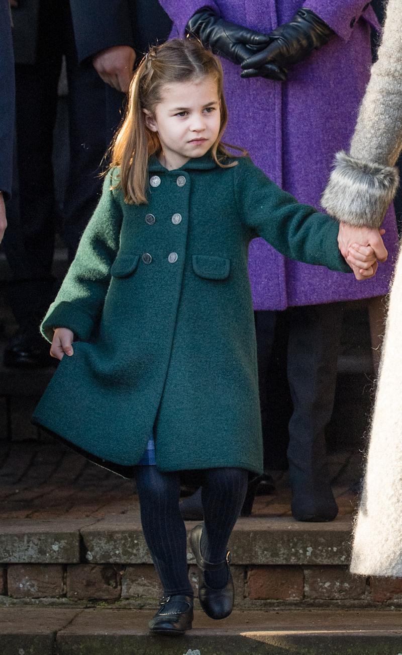 Princess Charlotte of Cambridge attempts a curtsey to the Queen at the Christmas Day Church service at Church of St Mary Magdalene on the Sandringham estate on December 25, 2019 in King's Lynn, United Kingdom.