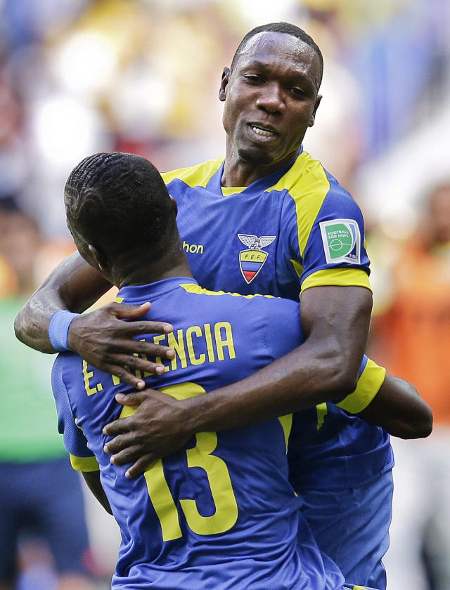 Ecuador's Walter Ayovi, right, celebrates with opening goal scorer Enner Valencia during the group E World Cup soccer match between Switzerland and Ecuador at the Estadio Nacional in Brasilia, Brazil, Sunday, June 15, 2014. (AP Photo/Michael Sohn)