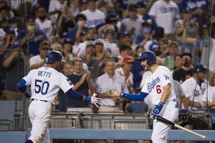 Los Angeles Dodgers' Trea Turner, right, celebrates with Mookie Betts, who hit a three-run home run.